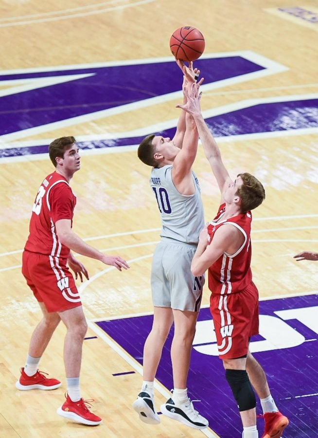 Miller Kopp jumps for the ball. Kopp scored four points on three field goal attempts as No. 21 Wisconsin defeated Northwestern 68-51.