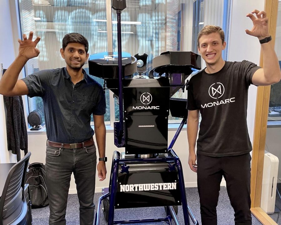 Bhargav Maganti (left) and Igor Karlicic with Northwestern's customized Seeker. The Seeker is the world's first robotic quarterback, and it uses tracking technology to make passes more accurate and practices more efficient.