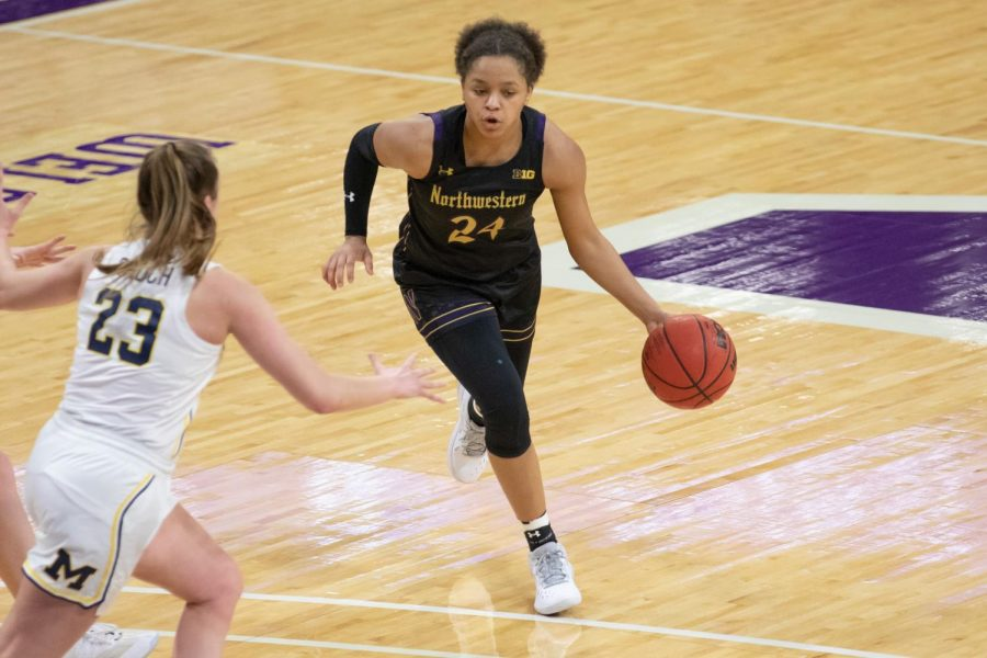 Jordan Hamilton dribbles the ball through half court on an offensive drive against Michigan on Jan. 3. Against Michigan State on Sunday, she chipped in with eight points and three rebounds in a winning effort.