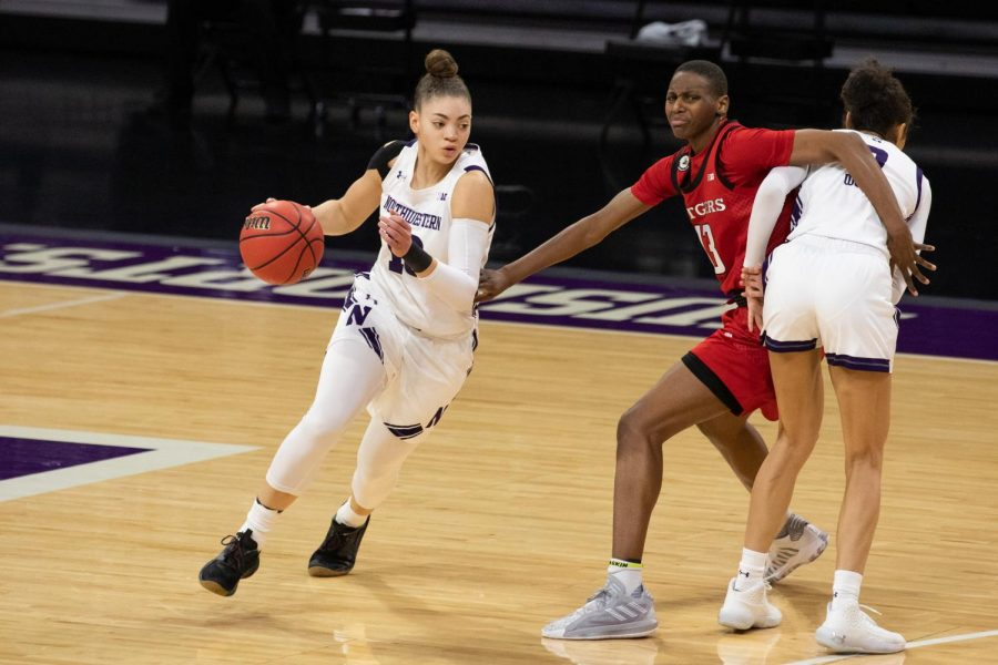Lindsey+Pulliam+dribbles+past+a+Rutgers+defender.+No.+21+Northwestern+will+not+play+Sunday+after+its+game+against+No.+12+Ohio+State+was+postponed.+