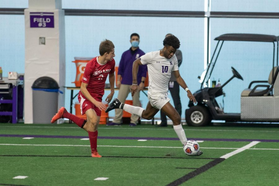Ugo Achara Jr. races down the sideline. The sophomore forward's goal in the 87th minute lifted Northwestern to a 1-0 victory over Indiana.