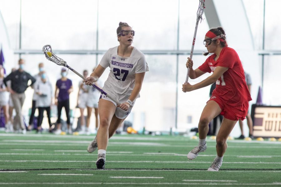 Junior attacker Izzy Scane looks down field. Scane tied Northwestern's single-game goal record during Sunday's match-up against Ohio State.