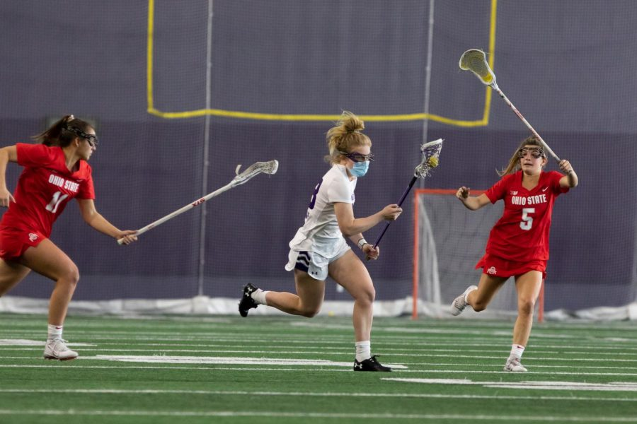 Lindsey McKone runs down field during Northwestern lacrosse's season opener on Feb. 14.