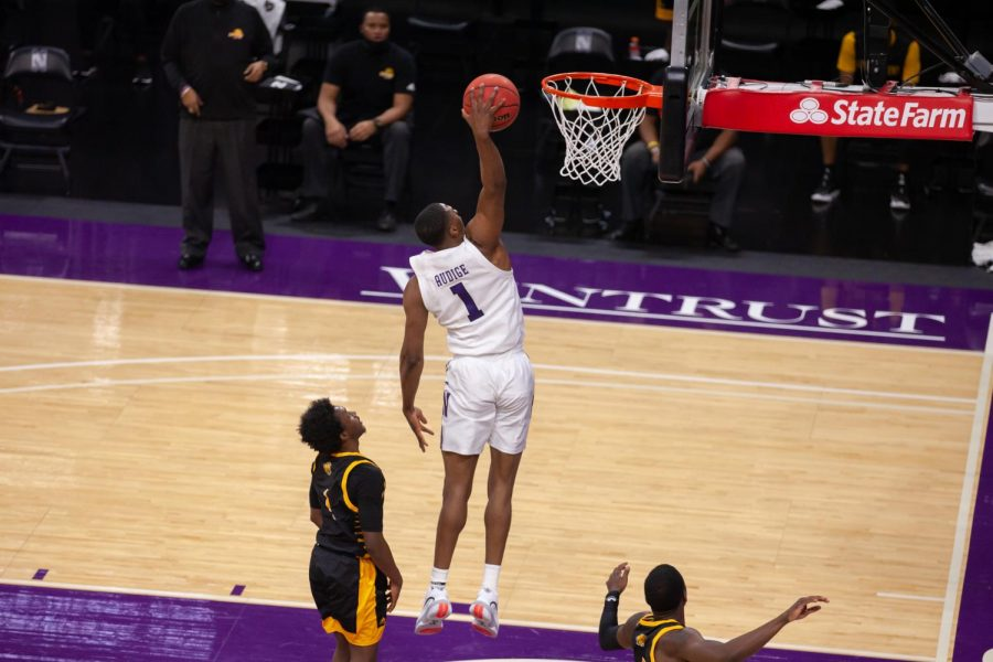 Chase Audige dunks. The redshirt sophomore guard had 11 points in Northwestern's 64-50 loss to No. 25 Rutgers.