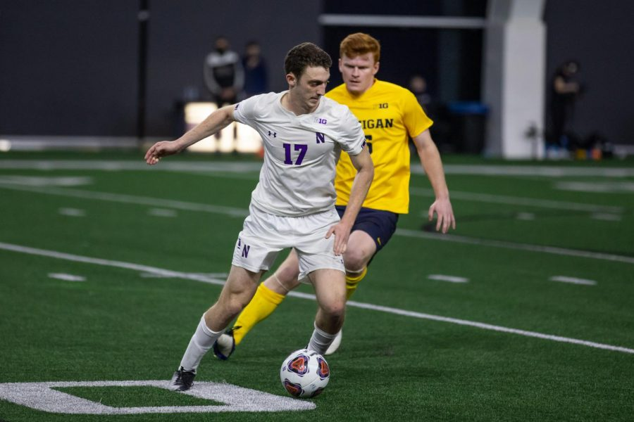 Rom Brown dribbles the ball. The freshman midfielder registered an assist in Northwestern's 5-2 win over Wisconsin on Tuesday.
