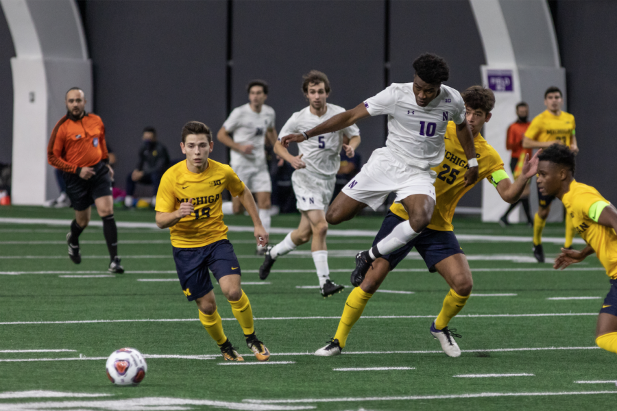 Ugo Achara Jr. catches up to the ball Friday against Michigan. On Tuesday against Wisconsin, the sophomore forward came through with his first two goals of the season, including a wonderstrike from inside the 18-yard box that put Northwestern up 3-0.