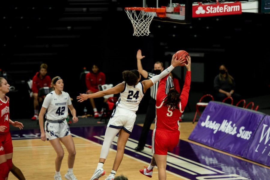 Senior guard Jordan Hamilton jumps to defend a shot taken by Ohio State. Hamilton scored 13 points against the Buckeyes.