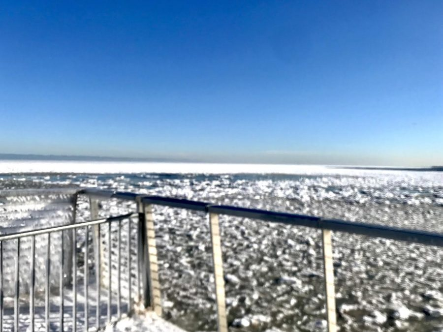 A thin layer of ice covers the lake due to the recent subzero temperatures.