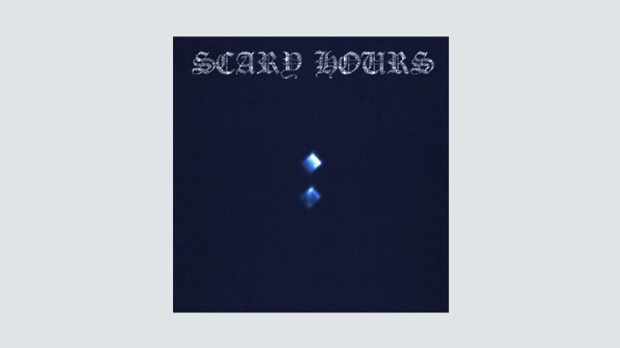 A dark blue album cover with two light blue diamonds.