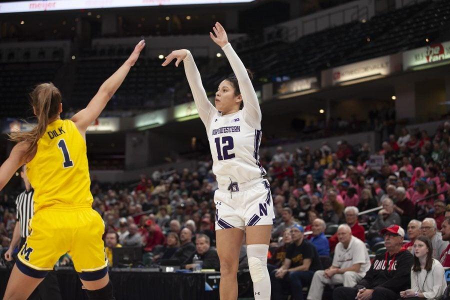 Northwestern's Veronica Burton shoots a jumper against a Michigan defender