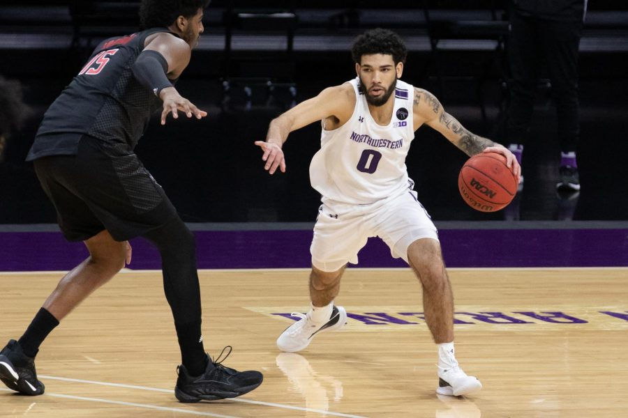 Sophomore guard Boo Buie drives against Rutgers. Buie led the Cats with 15 points and added a layup in the clutch as NU knocked off Maryland.