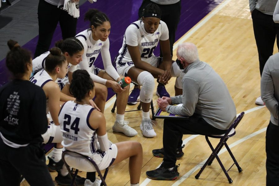 Joe McKeown speaks with his players on the sideline. Northwestern clinched a berth in the NCAA Tournament Monday for the first time since the 2014-15 season.