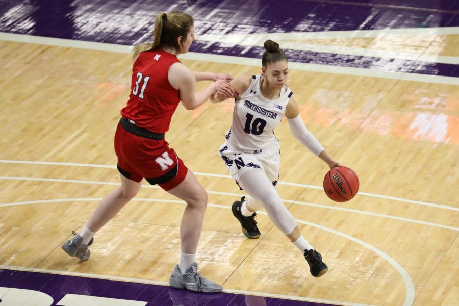 Lindsey Pulliam drives to the basket. The senior guard scored 21 points in Northwestern's win over Illinois.