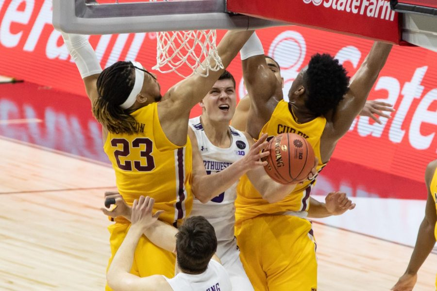 Men's player attempts a layup.