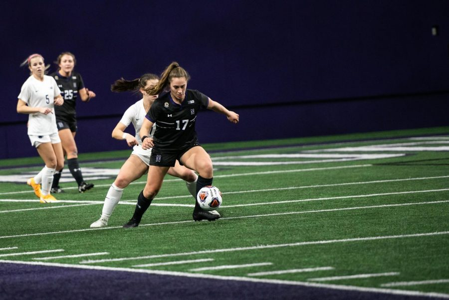 female soccer player dribbles with the ball