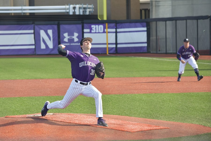 Northwestern player fires a pitch from the mound.