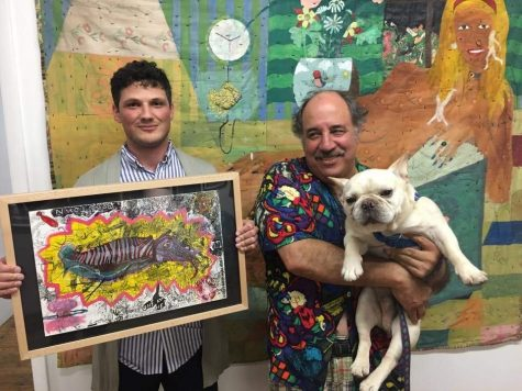 Luke Shemroske (left) holds a portrait of a squid like figure in a yellow and pink background. Next to him a man is holding a dog.