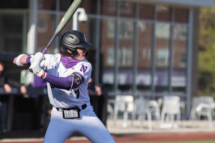Northwestern player readies for incoming pitch.