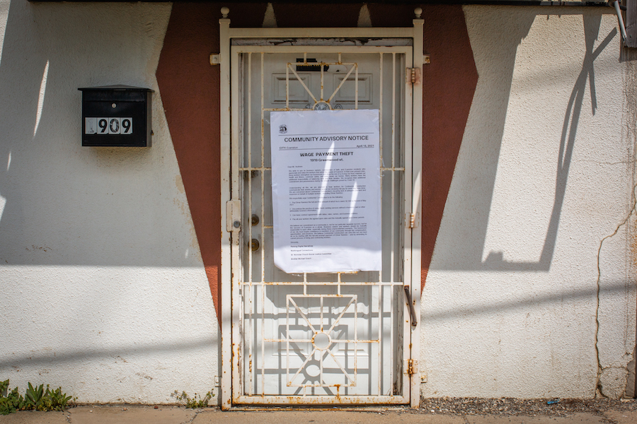 The door of the Continental Construction office in Evanston. Demonstrators taped a copy of a letter with a list of demands to the company's door.