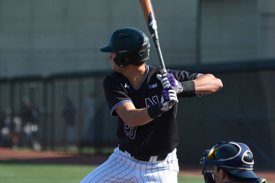 Northwestern player prepares to take a swing.