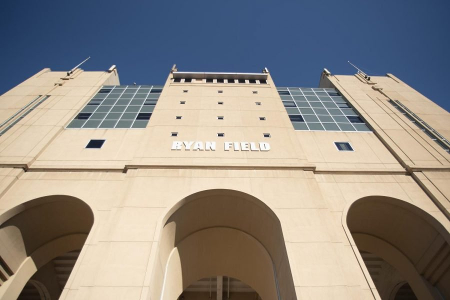 """A tan building with """"Ryan Field"""" written in white lettering."""