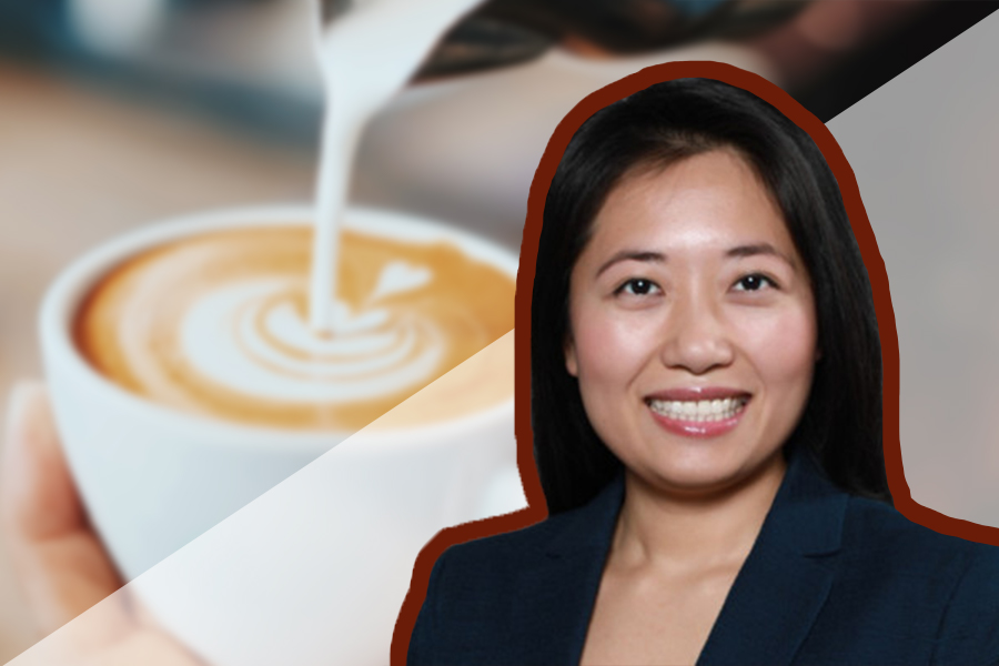 A woman's headshot in front of the background of a cup of coffee