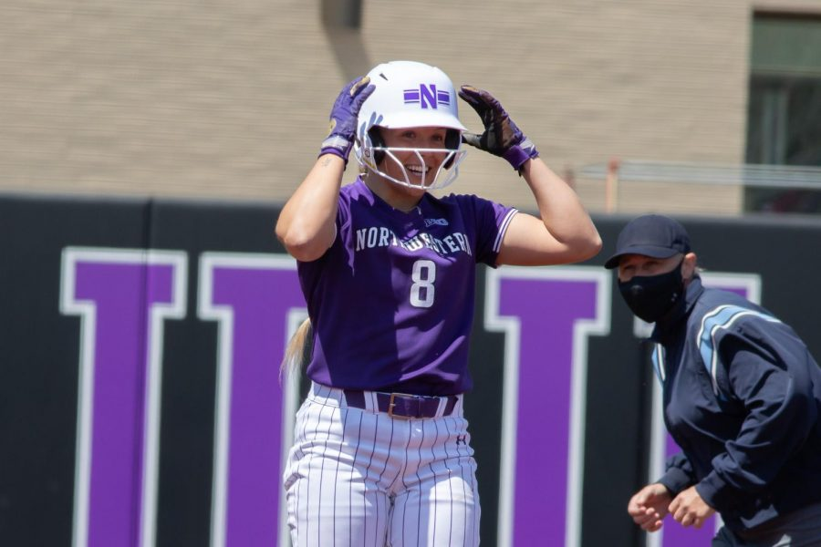 Skyler Shellmyer adjusts her helmet. Shellmyer was one of four Wildcats selected to the First Team All-Big Ten on Wednesday.