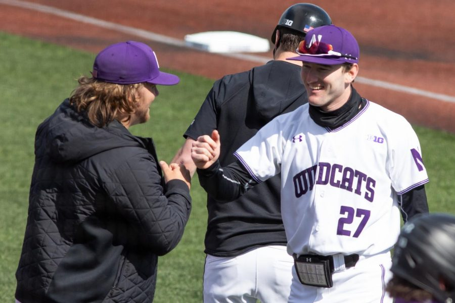 Northwestern player offers a fist bump on the field.