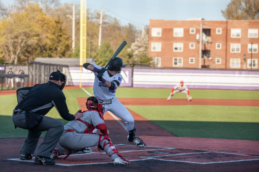 Northwestern player prepares to hit the baseball.