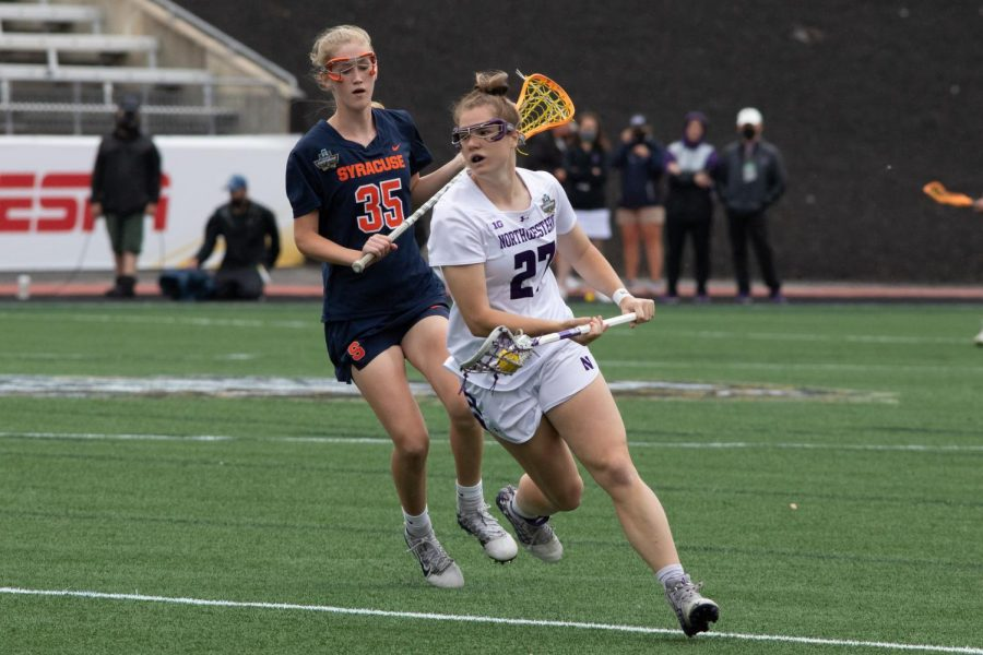 Izzy Scane runs with the ball. The junior scored four goals in Friday's semifinal loss to Syracuse