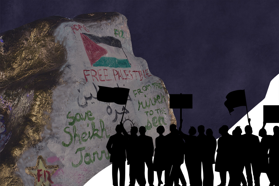 The+Rock%2C+with+gold+siding+and+words+%E2%80%9CFree+Palestine%E2%80%9D+among+others.+The+background+is+dark+blue+with+silhouettes+of+people+with+signs+in+the+bottom+right+corner.