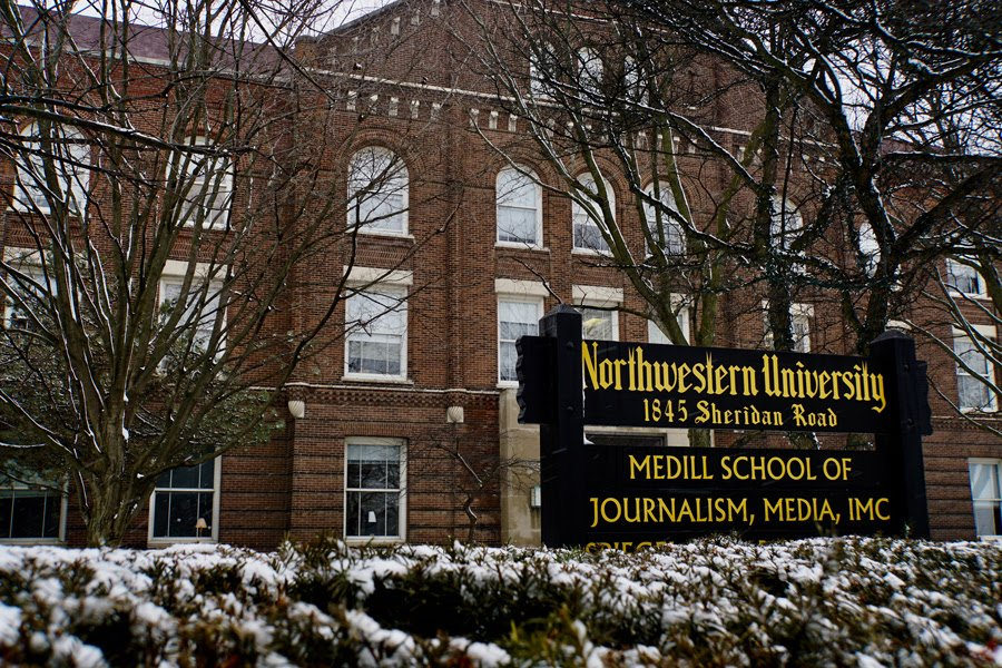 """Pictured is Fisk Hall, home to the Medill School of Journalism –– it's located at 1845 Sheridan Rd. A sign is pictured in front of the building, and it reads """"Northwestern University, 1845 Sheridan Road, MEDILL SCHOOL OF JOURNALISM, MEDIA, IMC."""""""