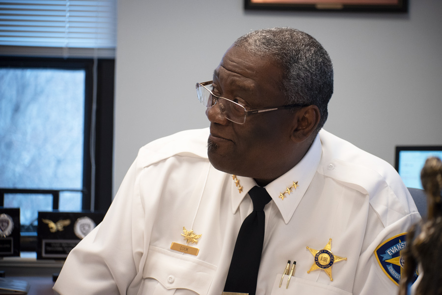 Demitrous Cook sits at a table while in uniform as chief of police.
