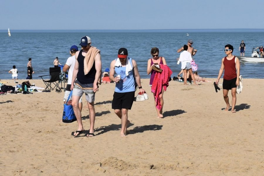 Students and Evanston residents walk on the beach near the Segal Visitors Center.