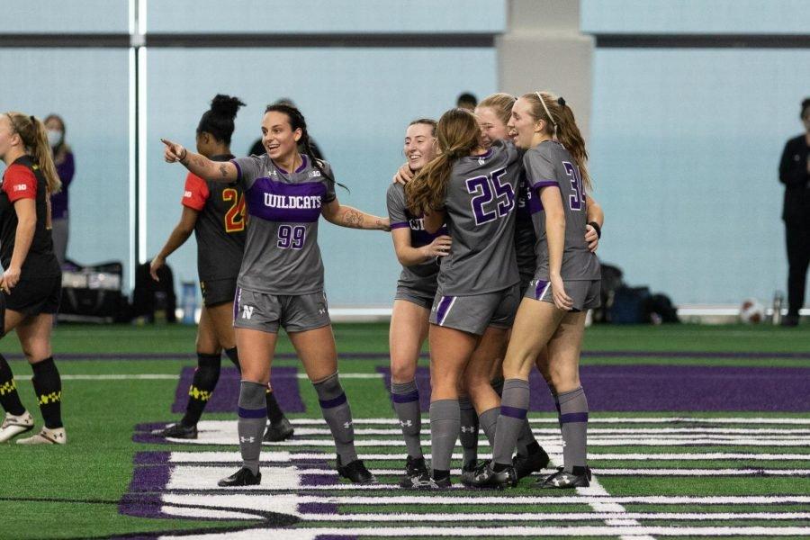 Northwestern womens soccer players celebrate.
