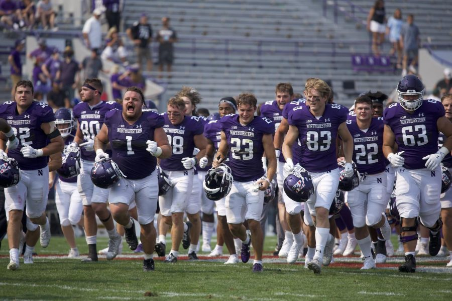 The Wildcats run toward the student section to celebrate the victory. Northwestern's win over Indiana State marked the Cats first game ever against the Sycamores.