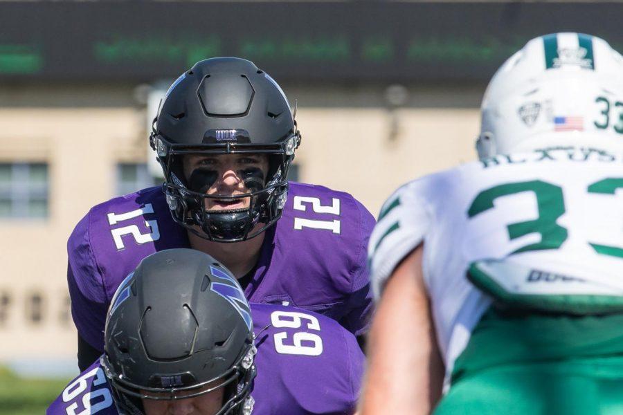 Football player eyes down the defense.
