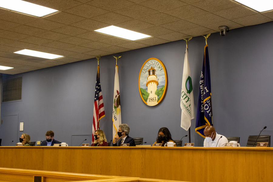 Several Evanston officials sit in the Council chamber during Monday's Council meeting. From left to right: 3rd Ward Councilmember Melissa Wynne, 4th Ward Councilmember Jonathan Nieuwsma, Interim City Manager Kelley Gandurski, Mayor Daniel Biss, City Clerk Stephanie Mendoza, and 5th Ward Councilmember Bobby Burns.