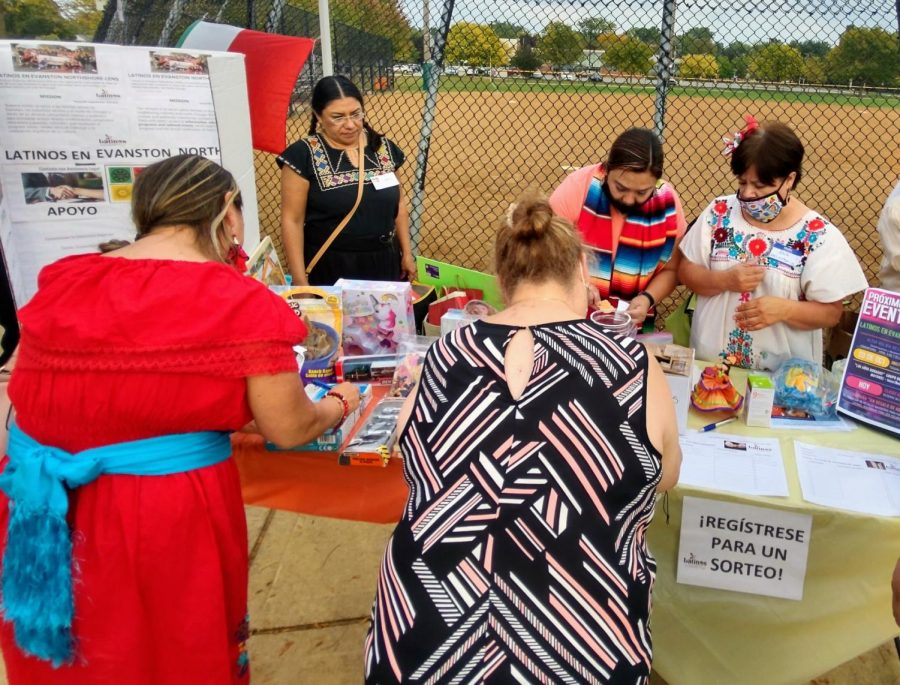 Volunteers at the Celebración de la Herencia Hispana event register attendees with sorteo, or giveaway. Attendees could also register for programs within Latinos en Evanston North Shore, like Los Años Dorados.