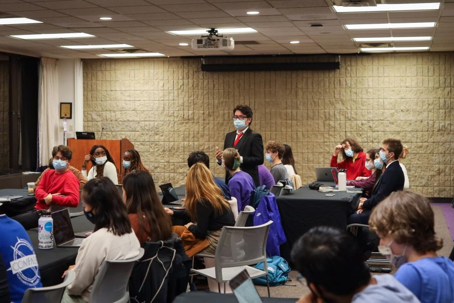 ASG senators sit in the Northwestern Room in Norris, masked, at an ASG meeting.