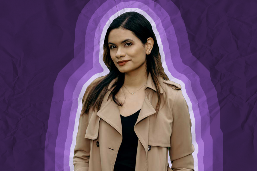 Angélica Casas in front of a dark purple background with four bands of increasingly darker shades of purple around her.