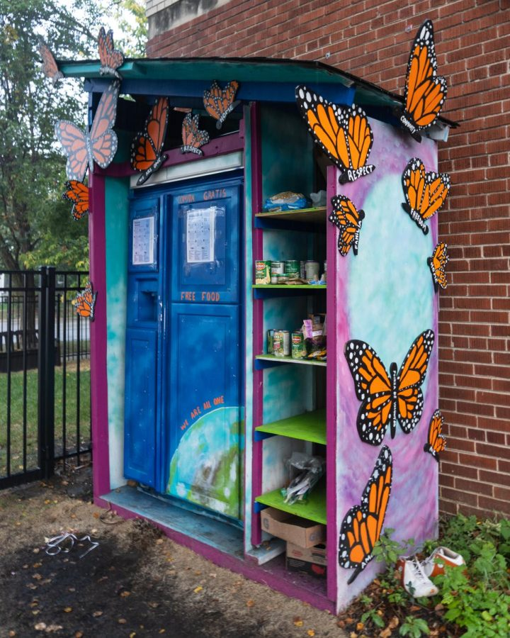 The community fridge outside Childcare Network of Evanston is decorated with butterfly decals.
