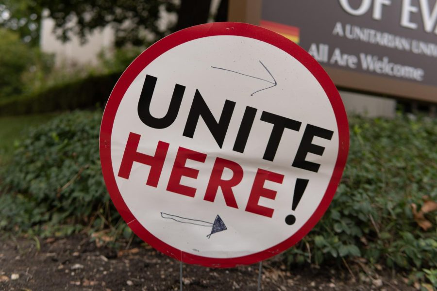 """A round sign that says """"UNITE HERE."""""""