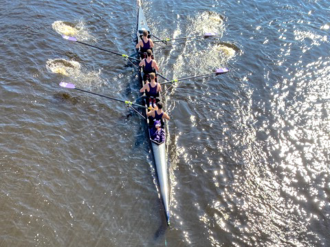 The men's club fours team rows in the Head of the Charles Regatta.