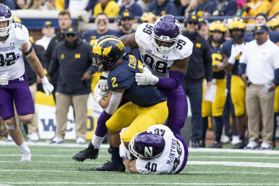 Michigan running back Blake Corum carries the ball against Northwestern. Corum gained 119 yards on 19 carries as the Wolverines ran away from the Wildcats 33-7 in Ann Arbor.