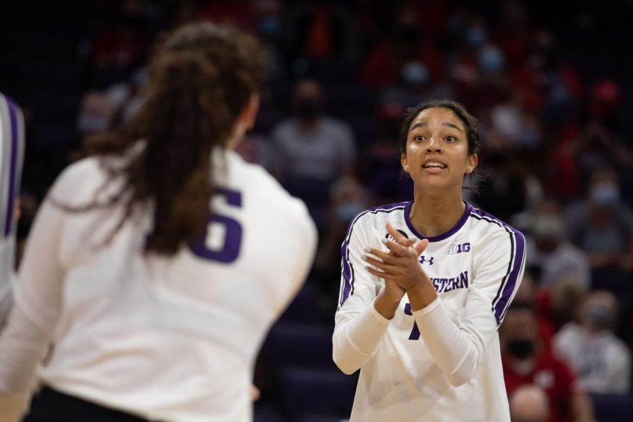 Volleyball player communicates to a teammate.