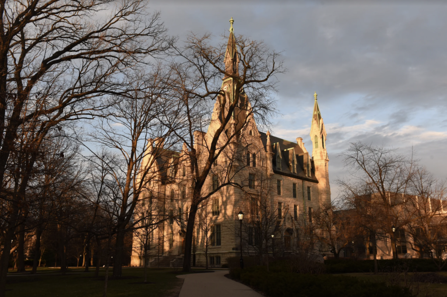 Southwest view of University Hall at sunset in the winter with Kresge Hall pictured to the right.
