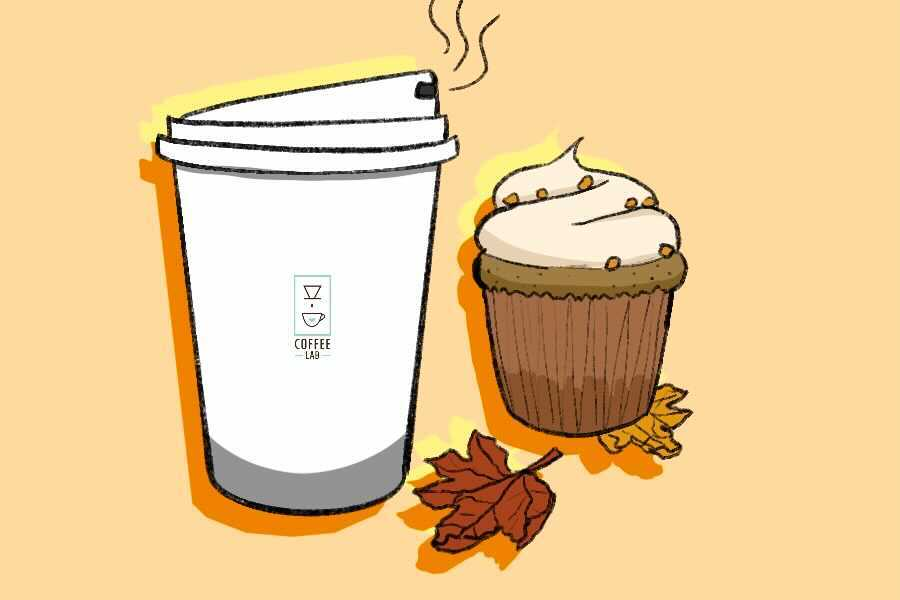 """A white coffee cup with a """"Coffee Lab"""" label on it sits next to a cupcake with light orange frosting and orange sprinkles and on top of a branch with two leaves– one dark orange, one light orange– against a light orange background"""