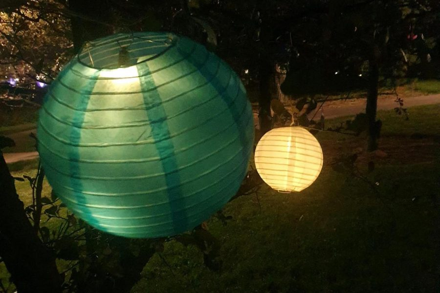 Evanston residents gathered under strings of lanterns.